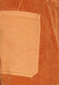 Replay - Trousers - metallic red - 2