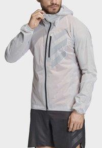 adidas Performance - TERREX AGRAVIC RAIN JACKET - Sports jacket - white - 1