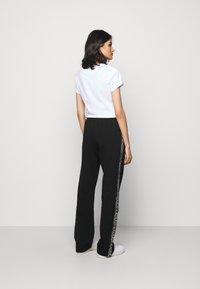 HUGO - NENNIFER - Pantalones deportivos - black - 2