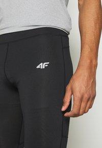 4F - Men's training leggings - Collants - black - 4