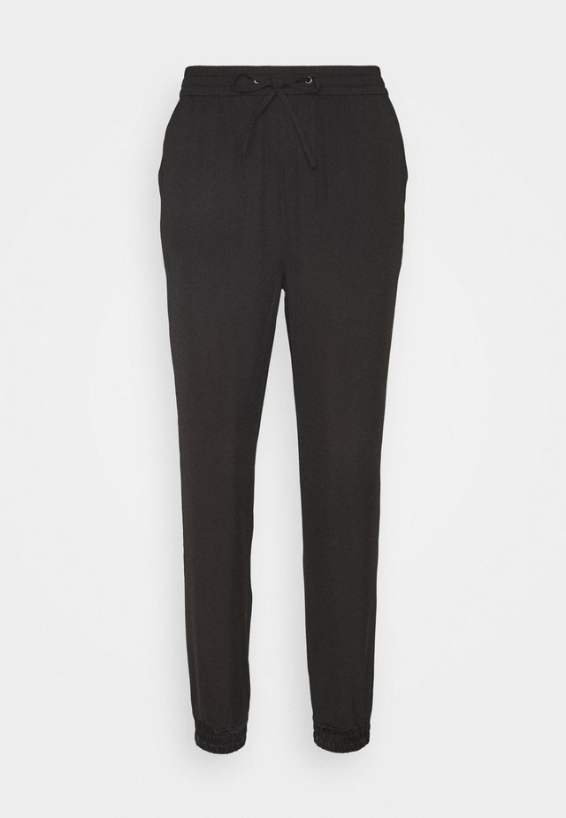 JUSTINE - Trousers - black