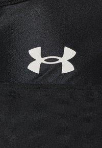 Under Armour - ROCK XBACK BRA - Medium support sports bra - black - 5
