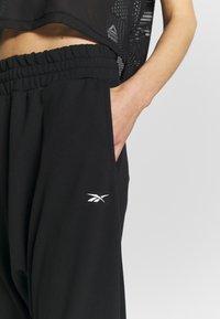 Reebok - STRIKER PANT - Tracksuit bottoms - black - 4