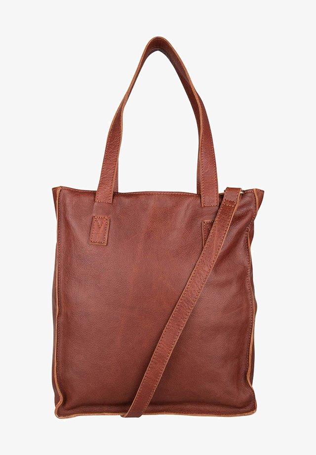 Shopper - bruin