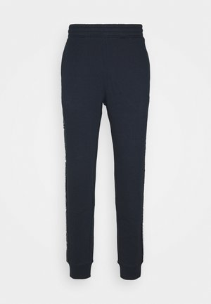 LEGACY  - Tracksuit bottoms - dark blue