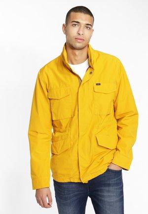 FIELD - Light jacket - golden yellow