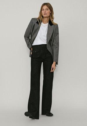 MIT ZIERTASCHEN - Bootcut jeans - black