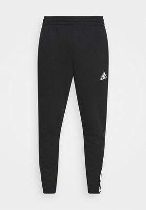 DK ESSENTIALS - Spodnie treningowe - black/white