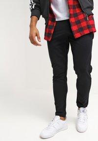 YOURTURN - Pantalones deportivos - black - 3