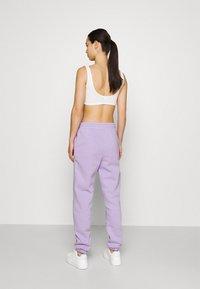 Monki - Pantaloni sportivi - lilac purple medium dusty - 2