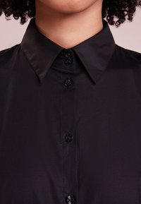 HUGO - ETRIXE - Button-down blouse - black - 3