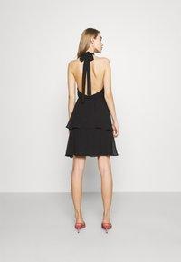 Gina Tricot - EXCLUSIVE MALVA HALTERNECK DRESS - Koktejlové šaty/ šaty na párty - black - 2
