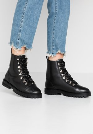 ANSEL - Lace-up ankle boots - black