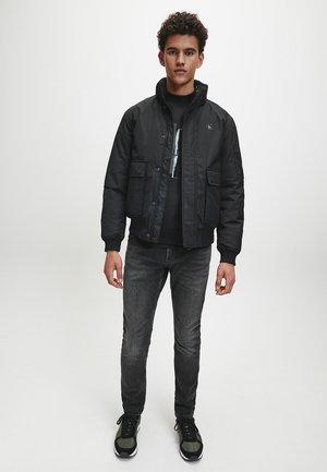 Slim fit jeans - black ck print
