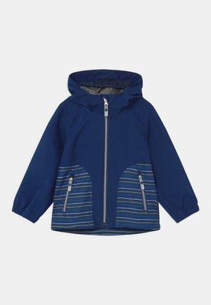 JOYLILY UNISEX - Waterproof jacket - dunkelblau