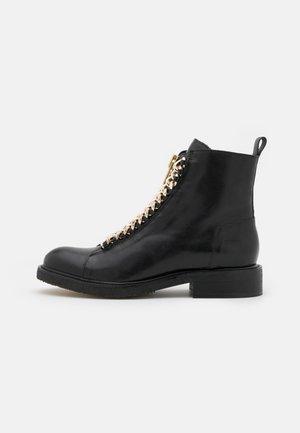 Kotníkové boty - black/metal gold