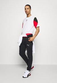 Puma - REBEL ADVANCED TEE - T-Shirt print - white - 1