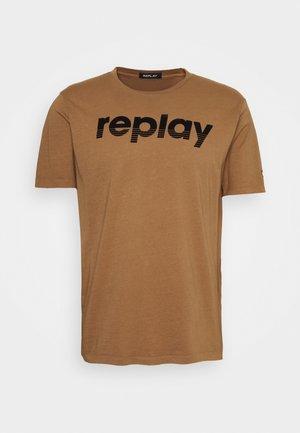 T-shirt con stampa - dark gold