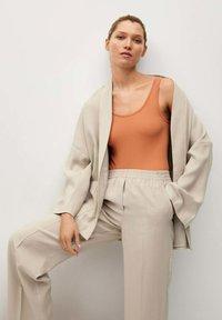 Mango - FLOWY STRAIGHT-FIT  - Trousers - ecru - 3