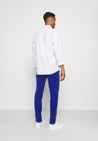 Tommy Jeans - SCANTON PANT - Trousers - blue - 2