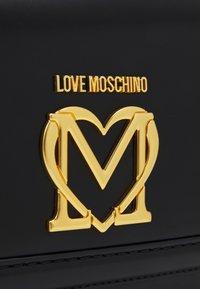 Love Moschino - SCARFED SHOULDER BAG - Sac bandoulière - nero - 6