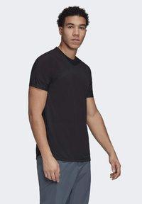 adidas Performance - ZUPAHIKE AEROREADY SHIRT - T-shirts med print - black - 0