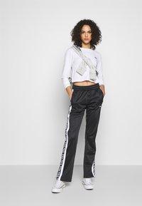 Fila - TAO - Teplákové kalhoty - black/bright white - 1