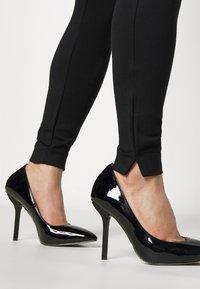 VILA PETITE - VIODINA  - Leggings - Trousers - black - 3