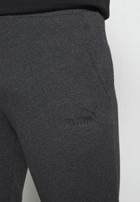 Puma - ESS LOGO PANTS - Tracksuit bottoms - dark gray heather - 4