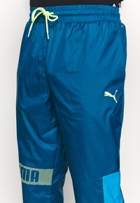 Puma - TRAIN PANT - Tracksuit bottoms - digi blue/energy blue/fizzy yellow - 5