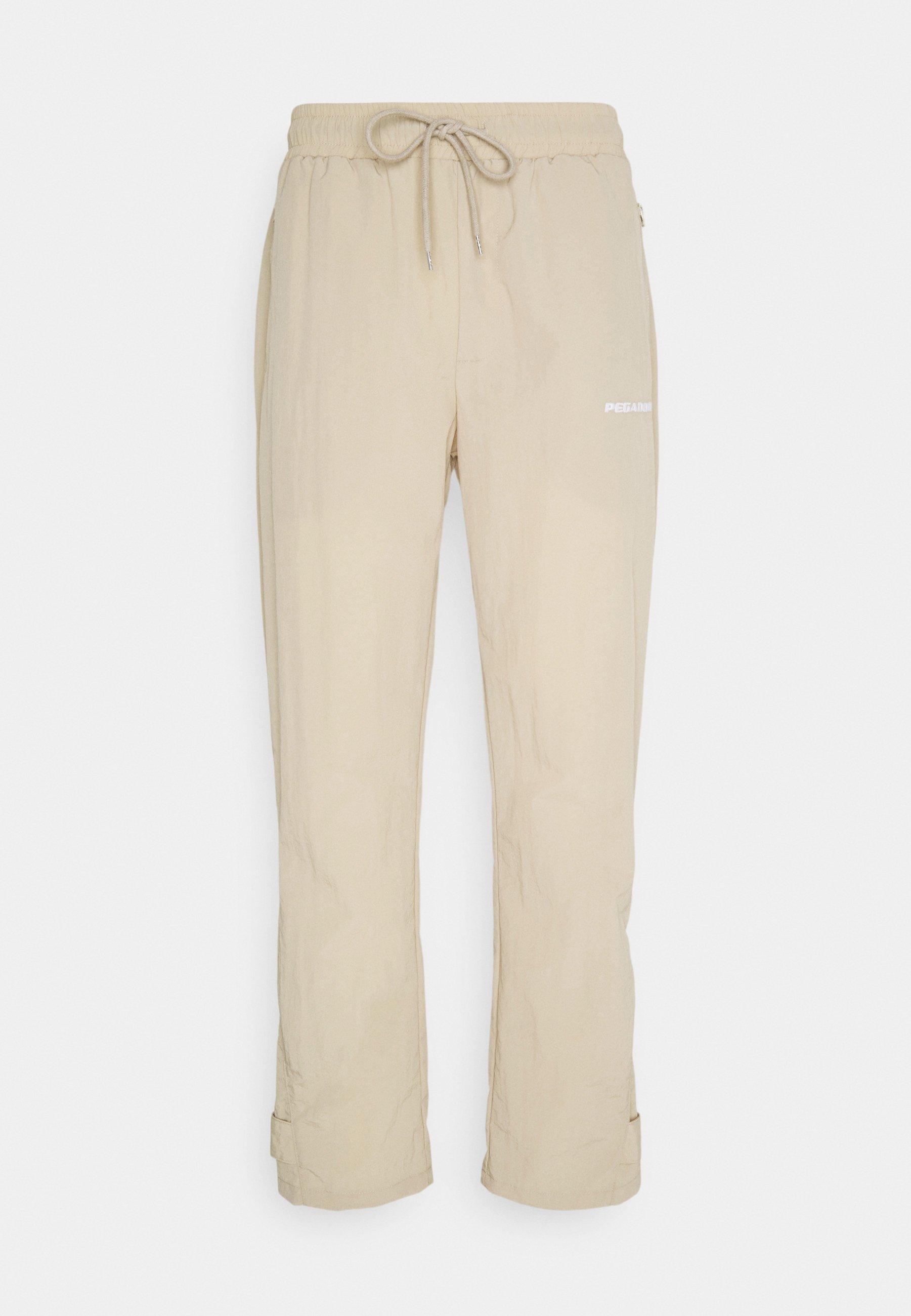 Women SHADOW WIDE TRACKPANTS - Trousers