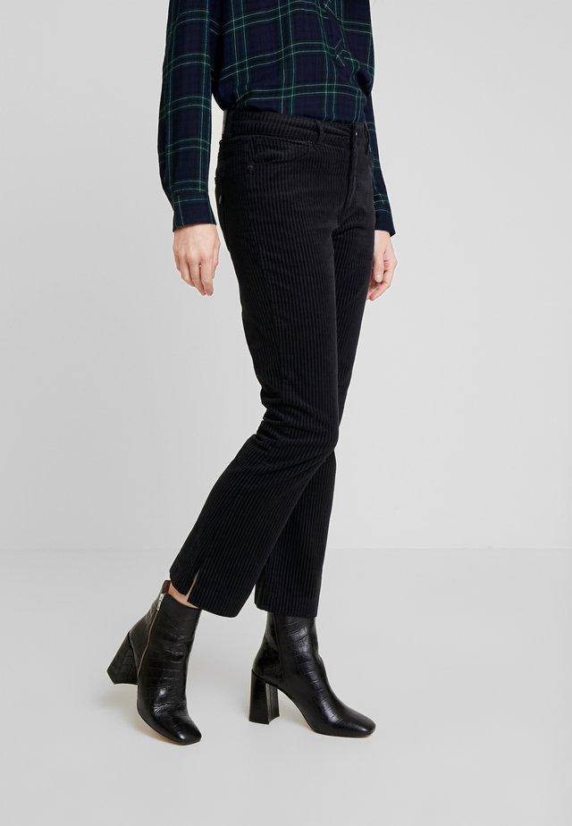 JELENA KICK FLARE - Spodnie materiałowe - black