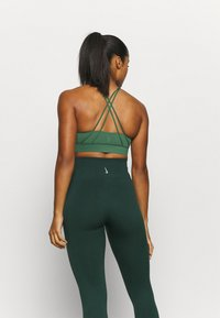 Nike Performance - LUXE BRA - Medium support sports bra - pro green/vintage green - 2
