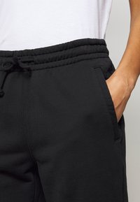DRYKORN - ONCE - Tracksuit bottoms - schwarz - 4