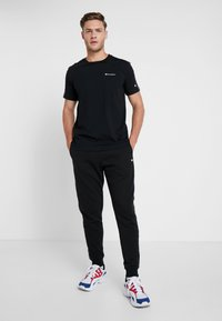 Champion - RIB CUFF PANTS - Tracksuit bottoms - black - 1