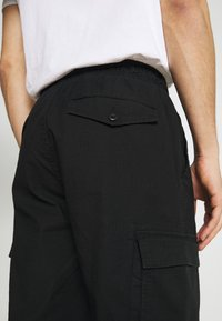 GAP - JOGGER - Cargo trousers - true black - 4