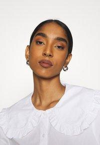 Monki - MADDY BLOUSE - Button-down blouse - white light - 3