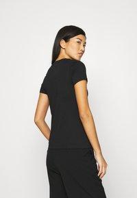 Calvin Klein Jeans - DISTORTED IRIDESCENT TEE - Print T-shirt - black - 2