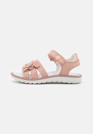 Sandaalit nilkkaremmillä - carne/cipria