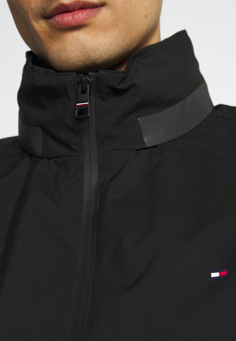 Tommy Hilfiger - STAND COLLAR JACKET - Lehká bunda - black