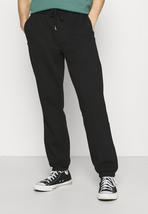 SWEATPANTS   - Verryttelyhousut - black