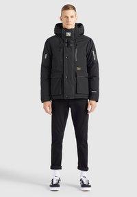 khujo - NANDU - Winter jacket - schwarz-schwarz kombo - 1
