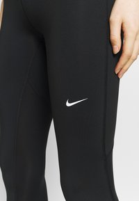 Nike Performance - 3/4 sports trousers - black/white - 5