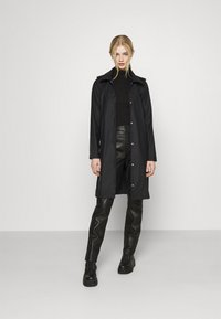 Vero Moda - VMSHADYSOFIA  - Waterproof jacket - black - 1