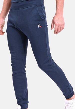 ESS  - Tracksuit bottoms - navy blue