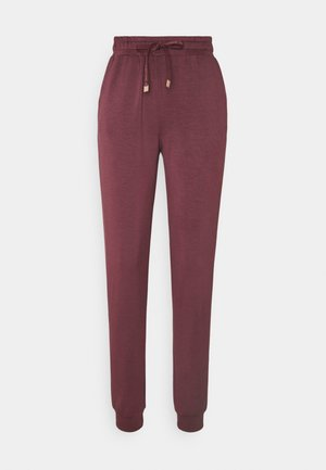 SC BANU 12 - Tracksuit bottoms - grape