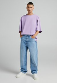 Bershka - TAPERED - Relaxed fit jeans - blue denim - 1
