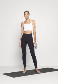 ARKET - Light support sports bra - white light - 1
