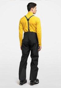 Haglöfs - LUMI LOOSE PANT - Snow pants - true black - 2