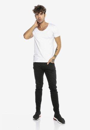 SAITAMA - Slim fit jeans - schwarz